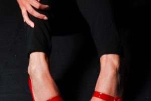 woman legs in red high heel shoes